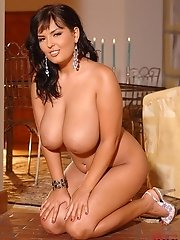 Jasmine Black stripping & licking her gigantic breasts!