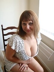 My wife showing us her huge breasts