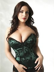 Hot busty Desiree poses and teases in green corset