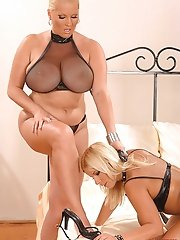 Horny blondes Laura M & Lucy Love playing with each other